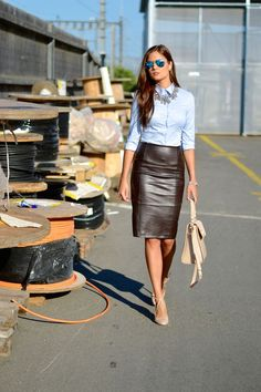 Black veggie leather pencil skirt with aviator shades, blue button up, and tan heels and purse.  Who says leather can't be preppy.. Buy the supplies to make this: http://mjtrends.com/pins.php?name=black-veggie-leather-fabric