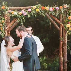 Brides.com: 73 Amazing Ceremony Structures An urban ceremony altar with metallic silver balloons and hanging string bulbs. Photo: Clean Plate Pictures
