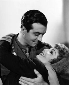 John Payne and Claudette Colbert