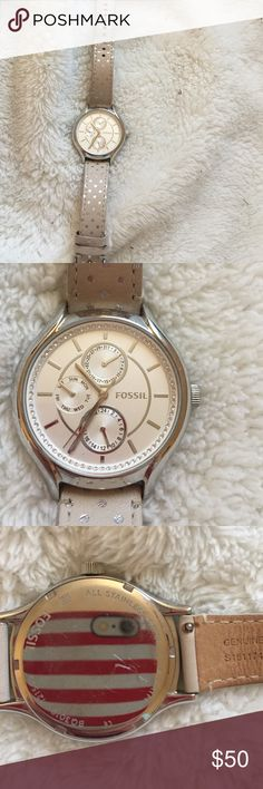 Silver Fossil watch! Worn a handful of times, interchangeable bands & i have the brown one someone that I'd find for you! Three analogs telling the date, military time & day of the week. Little scratches on the back as pictured. Fossil Accessories Watches