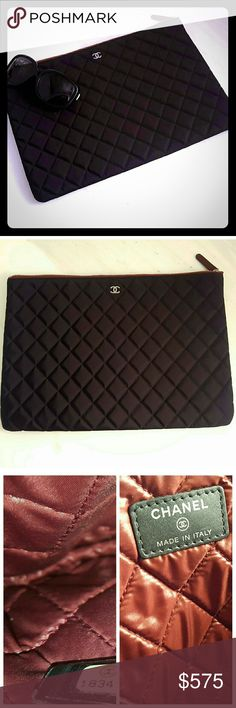 Authentic Chanel Oversized Clutch Amazing clutch that fits a lot. It is grossly sized and can even fit an iPad in it. It is a nylon material which makes this easy to use and care for. Zipper closure along the top no pockets. No trades. Thus is perfect to slip into those bigger totes to keep your personal items enclosed in its own pouch. 100% authentic. Still looks new. Only used a few times. I have another one I use more. CHANEL Bags Clutches & Wristlets