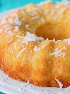 Pineapple Coconut Bundt Cake Recipe Desserts with yellow cake mix, crushed pineapple, sweetened coconut flakes, orange juice, powdered sugar Mini Desserts, Just Desserts, Delicious Desserts, Cake Mix Recipes, Baking Recipes, Dessert Recipes, Coconut Recipes, Bunt Cakes, Cupcake Cakes