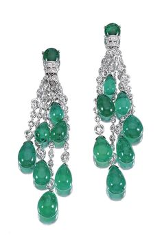 PAIR OF EMERALD AND DIAMOND EAR PENDANTS. Each of cascade design, suspending seven emerald drops from articulated chains of various lengths spectacle-set with brilliant-cut diamonds.