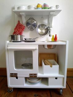 Play kitchen ideas...want the high shelf and low drawers; like the clean oven door, like that there is no microwave, like the sink spout.