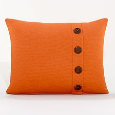 rust pillow with buttons