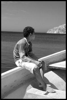 Boy in boat, Taganga, Colombia
