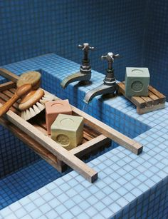 If it wasn't that hospital blue this bathroom would be perfection. I find the Japanese bath accessories very soothing.