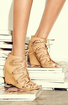 The leaf cut-outs on this lace-up wedge sandal are oh so pretty.