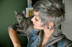 I've never seen hair dyed grey before, but I'm liking it on her.