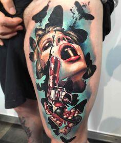 gun girl and butterfly tattoo