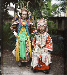 Life back then: A couple pose in traditional costumes in Tonkin, south Vietnam, a century ago. The photo is one of 72,000 autochromes taken ...