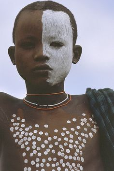 Surma boy in Ethiopia.  Photography by Frans Devriese