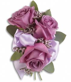 "Special Wrist Corsage (D2) - Ray Hunter Florist & Garden. SKU: T201-8A Product Description  Our "" Student Special Wrist Corsage "" shown here with lavender roses, pink limonium and seeded eucalyptus. We can create this corsage in your unique colors. Bring in your dress swatch and let's create it together!"