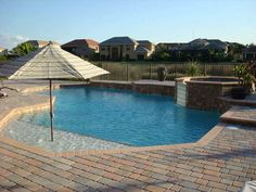 pools with beach entrance | Pool Companies - Champion Pools & Spas - West Palm Beach Florida