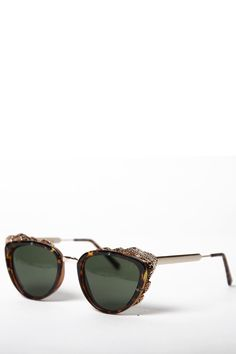 Protect your eyes with style: Lovely cat-eye shades by Spitfire featuring a tortoise elegant cat-eye acrylic frame with textured gold tone hardware at upper and side frame. Sold with a branded case.
