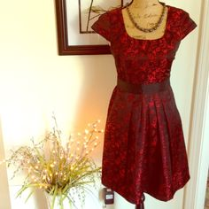 "Gorgeous Party Dress by Minuet Super cute party dress by Minuet. Deep red and black with roses printed on it. Buttons at back of neck and back at waist. Cap sleeves. NWT. Zips at side. Polyester. 33.5"" length and bust is 34"". Beautifully detailed! Minuet Dresses Mini"