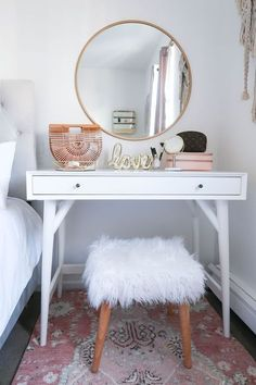 Styling A Vanity In A Small Space - Money Can Buy Lipstick | Styling A Vanity In A Small Space | White and Gold Bedroom | White and Gold Vanity | New York City Apartment | Small Apartment | DIY Vanity | Blush Bedroom | Neutral Home Decor | White and Gold Home Decor | Blush Print Rug | Faux Fur Wood Stool #DIYHomeDecorGold