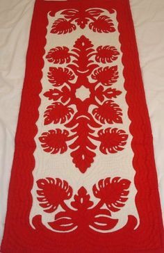 Hawaiian quilt table runner 100% hand quilted/hand appliqued Hawaiiana by Hawaiian Quilts & Gifts. $59.95. 100% Brand New Hawaiian Handmade Table Runner / Wall Hanging 20x50. 100% Hand Quilted and 100% Hand Appliqued. Red Monstarra Design. There's a count of 6-8 stitches in an inch. It has 3 loops in the back where you can insert a rod for easy hanging. ALOHA, this quilt is made of 65% Polyester and 35% Cotton.  Which makes the quilt 100% machine washable.  We h...