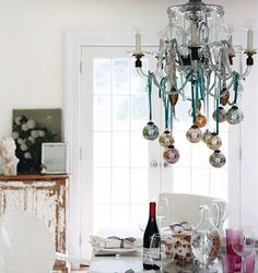 Love the ornaments hanging from the chandelier!!!