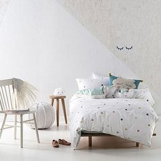 Inject gentle colour into your little one's bedroom with the watercolour polka-dots of the Jenny Quilt Cover Set from Marie Claire.