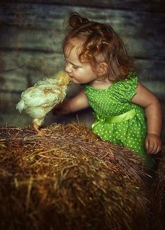 OMG this little girl and chick is so cute! ;)