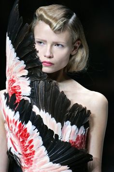 Alexander Mcqueen. Haute couture dress.  Bodice of feathers in black peach and red.  Stunning!