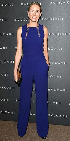 NAOMI WATTS Naomi accessorizes her royal-blue Elie Saab jumpsuit with luxe accessories – diamond-and-onyx drop earrings, a Lipstick Daily leather clutch and a major Bulgari statement watch – at a party hosted by the accessories brand at the Baselworld watch and jewelry show in Switzerland.