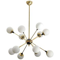 Italian Brass Chandelier | From a unique collection of antique and modern chandeliers and pendants at http://www.1stdibs.com/furniture/lighting/chandeliers-pendant-lights/
