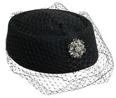 Classic Pill Box style hat in black with black netting to cover eyes Fancy Hat features a lovely rhinestone broach pinned to netting - broach is removable One size fit's most up to 21 inches - vintage pill box hat created from wool felt Also known as a Church Hat it is great for all types of special occasions