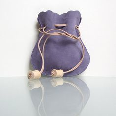 Leather drawstring pouch / drawstring purse handmade by RinartsAtelier