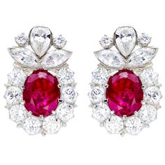 Platinum earrings feature approximately to 8 carat carats in natural faceted non-heated Burmese x x oval ruby. Framed by carats of stunning prong-set and bezel-set diamonds in round, marquise, and pear-shape cuts. Platinum Earrings, Ruby Earrings, Ruby Jewelry, Art Deco Jewelry, Cluster Earrings, Jewelery, Vintage Jewelry, Fine Jewelry, Jewelry Design