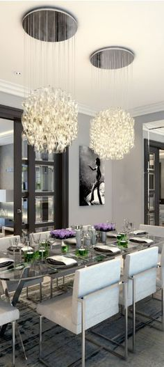 Very contemporary dining room! Don't you just love those chandeliers?!  #contemporary #dining #chandeliers