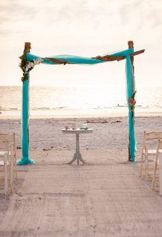#beachwedding #weddingarch #floridawedding #weddingdecor #tropicalwedding Beach Ceremony, Ceremony Backdrop, Ceremony Decorations, Simple Wedding Menu, Simple Weddings, Driftwood Wedding, Aqua Fabric, Beach Weddings, Backdrops