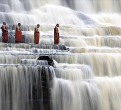 My first thought upon seeing this picture is look at those Buddhist monks, they practice Theravada Buddhism.