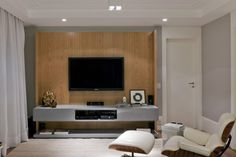 i like the idea of this tv unit - could be great as a DIY or custom made item... Nice contrast of wood and grey...