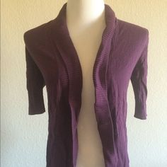 Express Purple Open Cardigan with Short Sleeves Gorgeous eggplant purple cocoon style flyaway cardigan with short sleeves. Great for work or casual. There were a couple of holes near the neck, but I sewed them up. This sweater is so comfortable and flattering. I just have too many of this style so I am parting with this one. Express Sweaters Cardigans