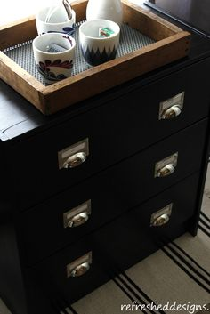 Ikea Rast hack using black paint and card catalog pulls.  Oh, ya....