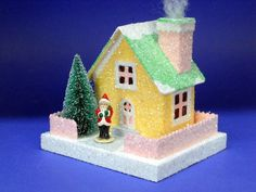 """Photo: classic cottage...4"""" x 5"""" base...5"""" tall including base...santa figurine is one i cast from a vintage original...he's only 1 1/2"""" tall...""""chimney smoke"""" is a whisp of quilting batting...aka...""""mountain mist""""..."""