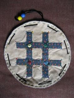 traveling tick tak toe bag , pull string, makes a pouch with game pieces in it