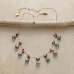 """***TO THE NINES NECKLACE*** $195 Labradorite briolettes, each crowned with a bubbly cluster of garnets, are evenly spaced along a delicate 14kt gold filled chain in this labradorite and garnet necklace. Handcrafted Sundance exclusive; lobster clasp. 16-1/2"""" to 17-1/2""""L."""