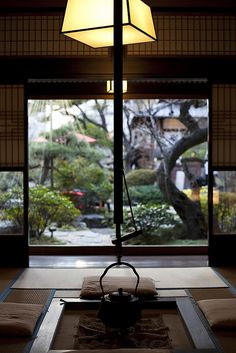 Private tea room overlooking Japanese gardens at Tofu-ya Ukai, Tokyo, Japan