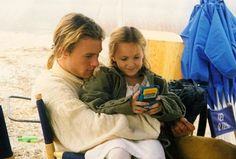 Heath Ledger and the little girl that played his sister in The Patriot behind the scenes. So sweet!