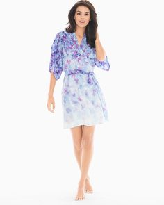 "Top off your sleepwear with a bit of luxe in this silky soft, short-sleeve robe. Short, kimono sleeves. Detachable belt. Length: approximately 36"" from shoulder on body. 85% polyester, 15% spandex. Machine wash. Imported."