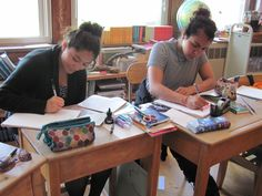 Grade 8 students working on their lesson books. 2014-15