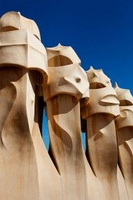 Barcelona, Spain.  Chimney pots on the roof of Casa Mila - also known as La Pedrera - designed by Antoni Gaudi.  Travel Photography Portfolio - www.coolephotography.co.uk