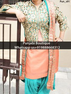 Stunning Peach With Turquoise Contrasted Punjabi Jacket Suit Product Code: Pun_s91 To order this dress , please call or WhatsApp us at +919888668312 or directly message us on FB We can design this Suit in any color combination or on any fabric (price may vary according to fabric) Punjabi Boutique's photo.