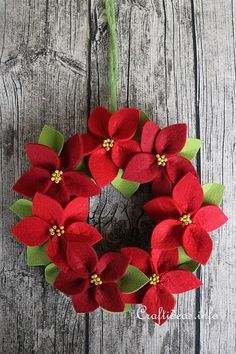 Add some holiday cheer to your dining room table with the Felt Poinsettia Christmas Wreath! The easy Christmas craft won't take long to make and can be reused. Felt Christmas Decorations, Felt Christmas Ornaments, Easy Christmas Crafts, Noel Christmas, Christmas Projects, Handmade Christmas, Easter Crafts, Crochet Ornaments, Christmas Swags