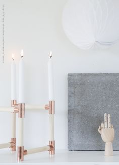 grandmother glamor / another, simpler version of the copper candelabra, this time w/wooden dowels