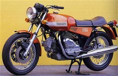 The 1975 Ducati sports an air-cooled, four-stroke, V-Twin powerplant paired to a five-speed manual transmissi. New Ducati, Moto Ducati, Ducati Motorcycles, Ducati Scrambler, Vintage Motorcycles, Scrambler Motorcycle, Motorcycle Engine, Ducati Models, Yamaha Rx100