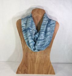 I hand-dyed this habotai silk scarf with indigo dye using the traditional Japanese Shibori technique called Arashi ( wrapped and compressed around a pole). The item pictured is exactly the item you will receive, it is a unique creation that cant be duplicated.  Whether you wear this Shibori silk scarf while working, traveling or attending a social event, it will be a versatile addition to your wardrobe.It has a lovely drape and feels luxurious around your neck. It is 72 X 14 and takes up…
